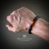 Carbon armband Oranje om pols